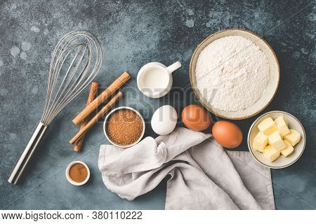 Baking Ingredients On Table. Eggs Flour Butter Sugar And Milk. Top View. Flat Lay Cooking Ingredient