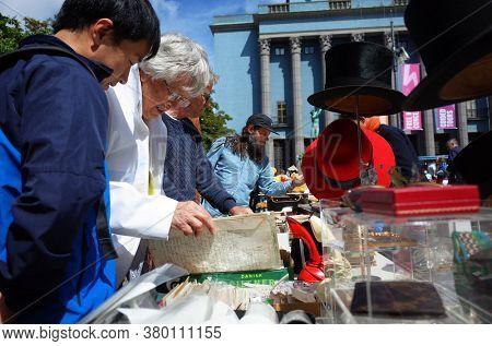 Stockholm, Sweden - Jul 07, 2019: People at flea market at Hotorget square in front of Concert Hall in central Stockholm