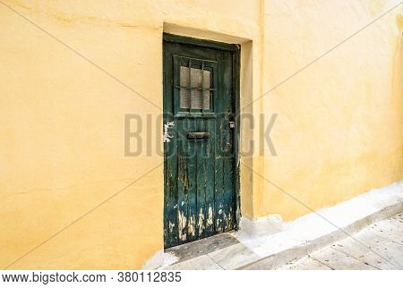 Old Door Of Residential Building In Plaka District, Athens, Greece. Plaka Is Tourist Attraction Of A