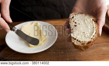 Bread And Butter. Smearing Butter On Sourdough Bread