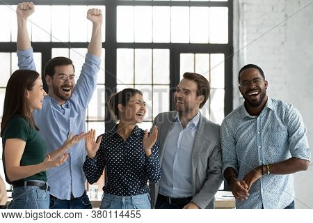 Overjoyed Happy Diverse Business Team Celebrating Success Together