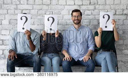 Confident Smiling Businessman Sitting In Row With Unknown People