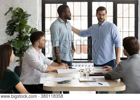 Executive Introducing New African American Employee To Colleagues