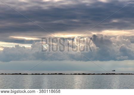 Dramatic Cloudy Stormy Sky Above The Sea At Sunset. Limassol Town Coastline Cyprus