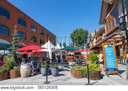 Banff, Canada - July 29, 2020: Tourists Dine Along Banff Avenue In Banff National Park. The Street W