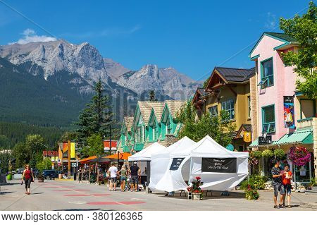 Canmore, Canada - July 30, 2020: Tourists Walking And Dining Along Popular Downtown Canmore In The C