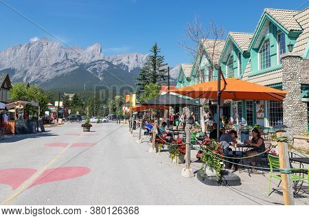 Canmore, Canada - July 30, 2020: Tourists Dining Along Popular Downtown Canmore In The Canadian Rock