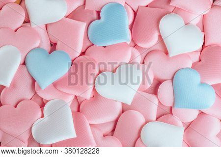 Valentine's Day Hearts Background. Holiday Abstract Valentine Background with pink, white and blue pastel color satin Hearts. Hearts backdrop. Love concept, wedding. Flat lay