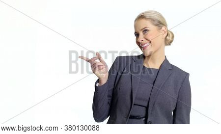 Young business woman pointing sth by a hand. On white background.