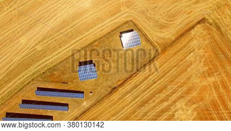 Solar panels in desert seeing from air. Sun energy from renewable source.
