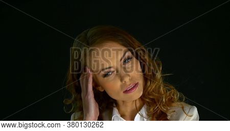 Caucasian woman in her thirties (30s) with head ache.