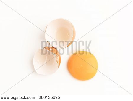 Raw Chicken Egg And Yolks Isolated On The White Background