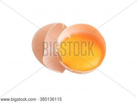 Egg Yolks In A Broken Shell Isolated On The White Background With Clipping Paths