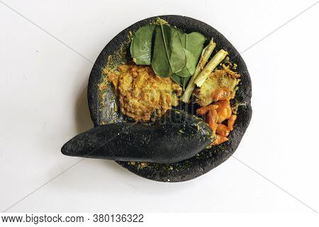 Traditional Stone Mortar And Pestle From Asia With Spicy Ingredients Chilli, Yellow Seasoning, Leaf,