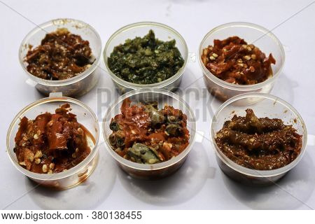 Aneka Sambal Indonesia. Five Kinds Of Indonesian Spicy Condiments Plated In Saucers Of Mini Bowl. A