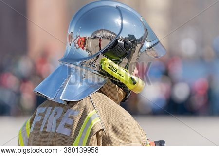 Back View Of Inscription Fire On Uniform Firefighter Emercom Of Russia, Ministry Of Civil Defence, E