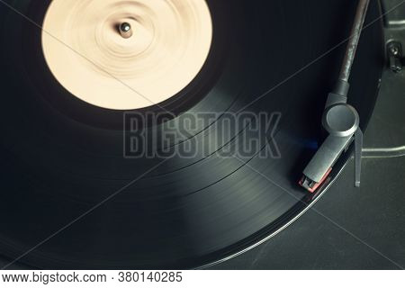 Retro Record Player With A Spinning Black Vinyl Record
