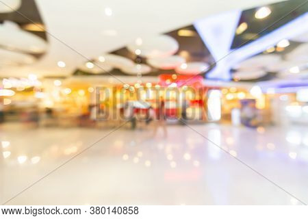 Abstract Blur Lights In Retail Shop Mall Background. Interior Clean Supermarket Lifestyle Concept Fo