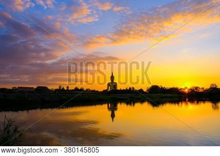Silhouette Of A Large Gold Buddha Statue At Wat Muang, Ang Thong Province, Thailand