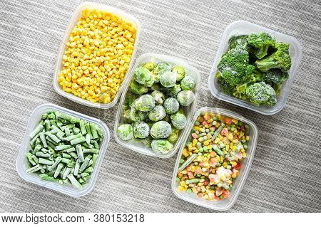 Plastic Containers With Frozen Vegetables On Grey Background, Top View, Different Frozen Vegetables
