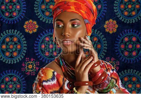 Portrait Of A Young Lovely African American Black Woman In The National African Clothes Against The