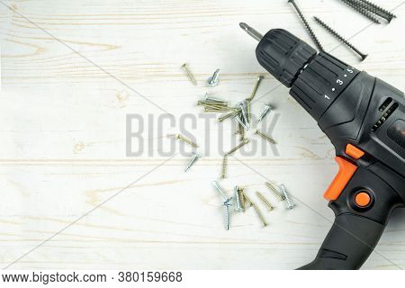 Diy Background With Electric Drill And Different Self-tapping Screws, Flat Lay Construction Light Wo