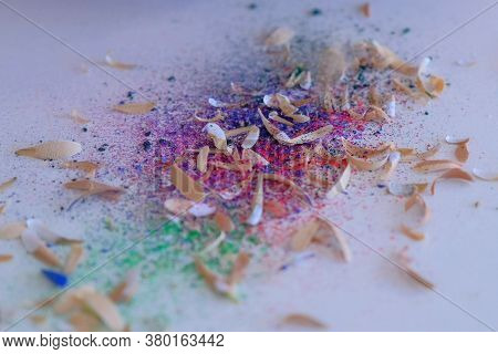 Colourful Shavings On White Table, Woman Painter Artist Is Sharpening Colourful Pencil Using Sharp K