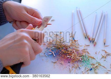 Woman Painter Artist Sharpening Orange Pencil Using Sharp Knife, Hands Closeup. Teacher Sharpen Oran