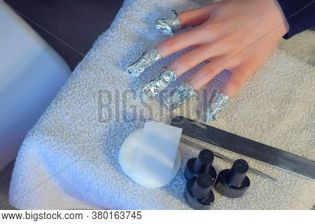 Woman With Wrapping Foil With Remover On Nails To Remove Shellac, Making Manicure Herself At Home, H