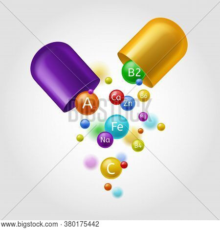 Vitamins. Colorful Open Capsule With Flying Multivitamin, Mineral Bubbles. Vitamin A, B And Zn, Fe A