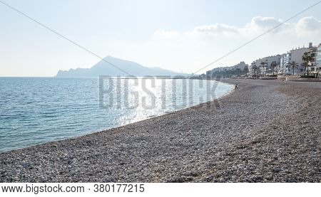 Stone Beach With View On Sunny Altea City Coastline And Mountains, Costa Blanca, Spain