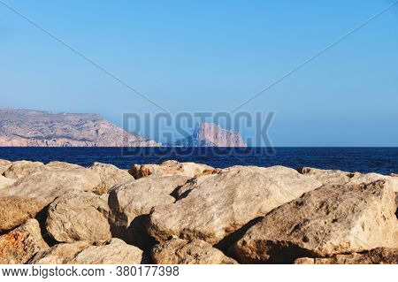 View To The Rock Of Calpe From The Rocky Coastline Of Altea With Cloudless Blue Sunny Weather, Costa