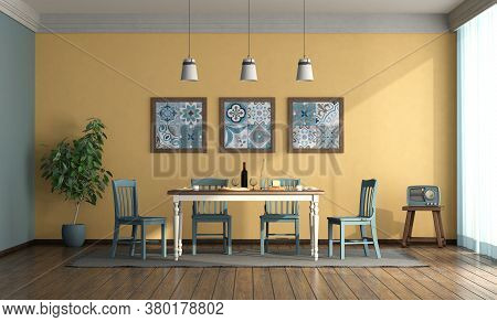 Vintage Style Dining Room With Blue Chairs ,wooden Table Against Yellow Wall - 3d Rendering