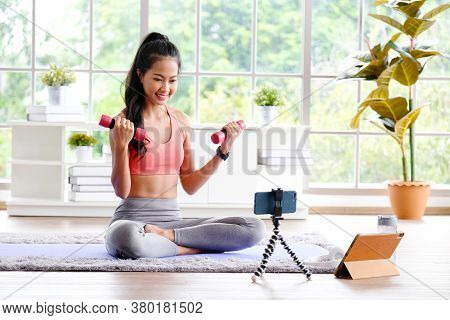 Exercise Online Training Class At Home, Asian Girl Holding Dumbbell For Workout Fitness, Healthy Asi