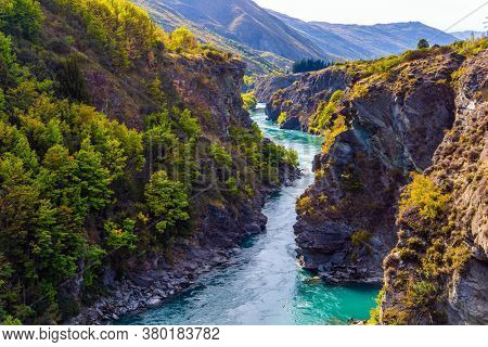 Picturesque gorge and river Kawarau between Queenstown and Cromwell. The river with bright green water. Incredible Adventures in New Zealand. The concept of extreme, active and photo tourism