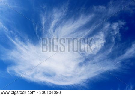 Clear Blue Sky With Plain White Cloud With Space For Text Background. A Whirlwind Of Objections In T