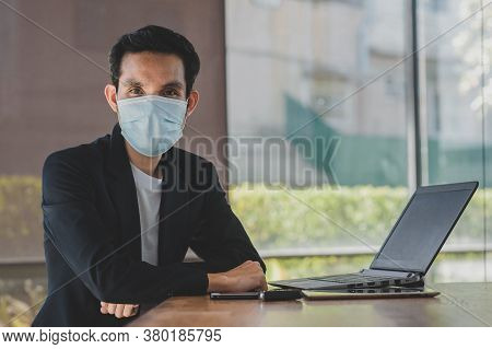 Asian Man A Wearing Face Mask Use Computer Freelancer Working From Home,concept Business Technology,