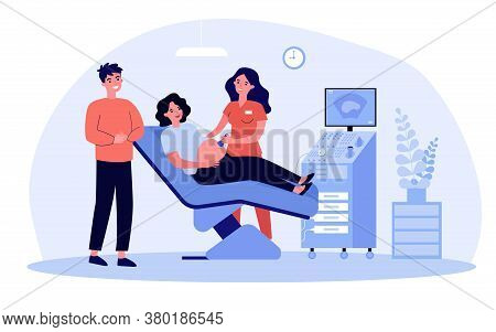 Expecting Couple Visiting Doctor For Ultrasound Test. Sonographer Using Scanner For Pregnant Woman E