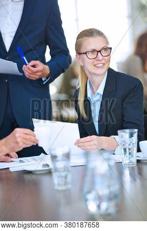Successful businesswoman negotiating contract in meeting