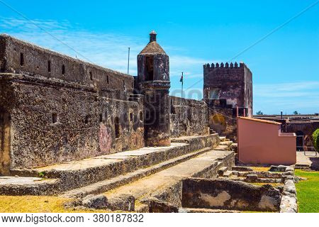 Bastion and loopholes in the thick ancient walls of the fortress.  Fort Jesus -  medieval fortification in Mombasa, Kenya. The concept of historical, educational and photo tourism