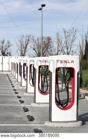 Sance, France - March 15, 2020: Tesla Supercharger Station. Tesla Is An American Automotive And Ener