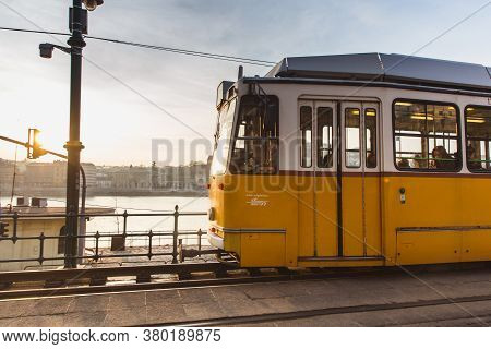 Budapest, Hungary - January 27, 2019: Yellow Tram In Budapest Near The Embankment On The Pest Side I