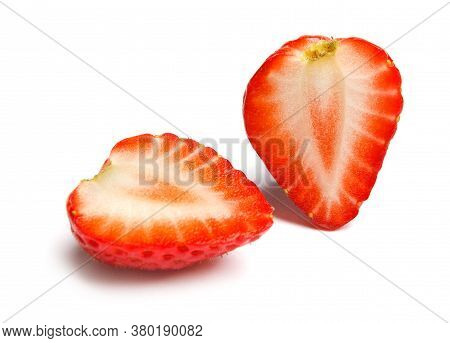 Strawberry. Cut Strawberries Into Pieces. Strawberry Slices Flying In The Air. Fresh Natural Strawbe