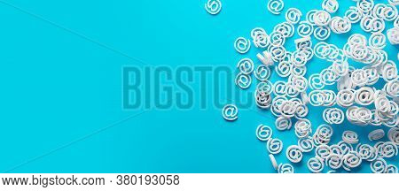 Heap Of White E-mail At Symbols On Cyan Background Banner Flat Lay Top View From Above, Contact Us O