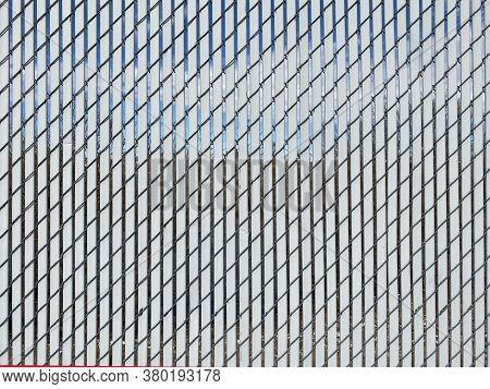 White Diagonal Metal Privacy Slat Fence Sunlight View Suitable For Website Marketing Background Back