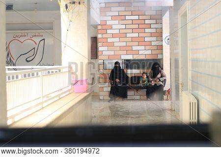 Aleppo, Syria 14 December 2019: Two Women Wait Their Turn Inside The Hospital