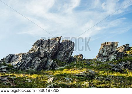 Sunny Highland Scenery With Sharpened Stones Of Unusual Shape. Awesome Scenic Mountain Landscape Wit