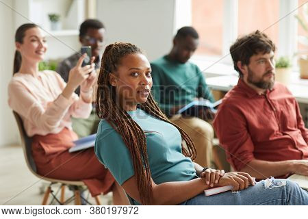 Multi-ethnic Group Of People Sitting In Audience During Training Seminar Or Business Conference In O