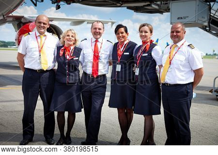 Kyiv, Ukraine - June 23, 2020: Airbus A320-214, Czech Airlines Pilots And Flight Attendants Standing