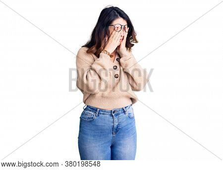 Beautiful young brunette woman wearing casual clothes and glasses rubbing eyes for fatigue and headache, sleepy and tired expression. vision problem